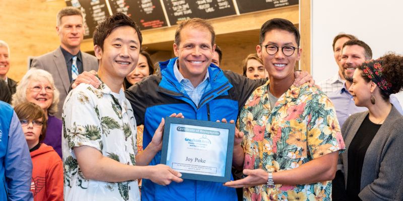 Joy Poke owner Justin, and partner Shaun, pose with the mayor of Troutdale, Casey Ryan